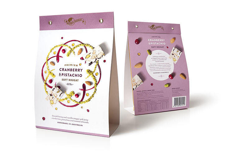 Mondo Nougat. Beautifully illustrated with artistic food designs:  Cranberry & Pistachio soft nougat package. Design by Dessein, Australia.