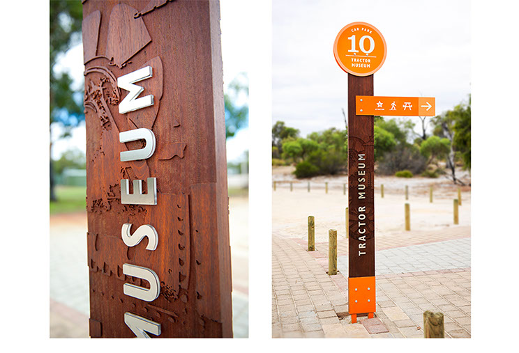Outside nature park sign design for Whiteman Park. Close-up wood texture and full sign view by Dessein, Australia.