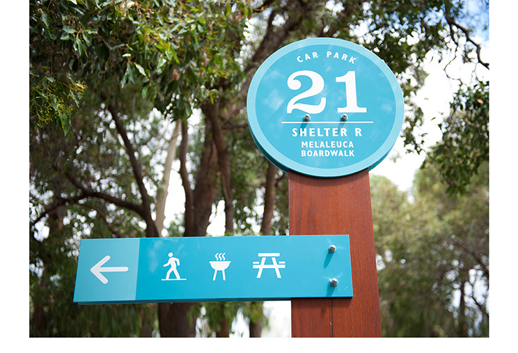 Park sign designs for Whiteman Park. Location 21 close-up top of car park sign with icons pointing to other locations by Dessein, Australia.